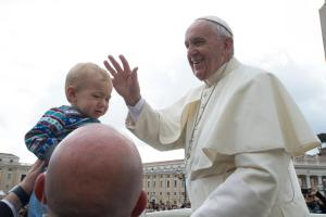 Baby from ProRome group, Mater Dei Parish, gets kissed by the Pope!